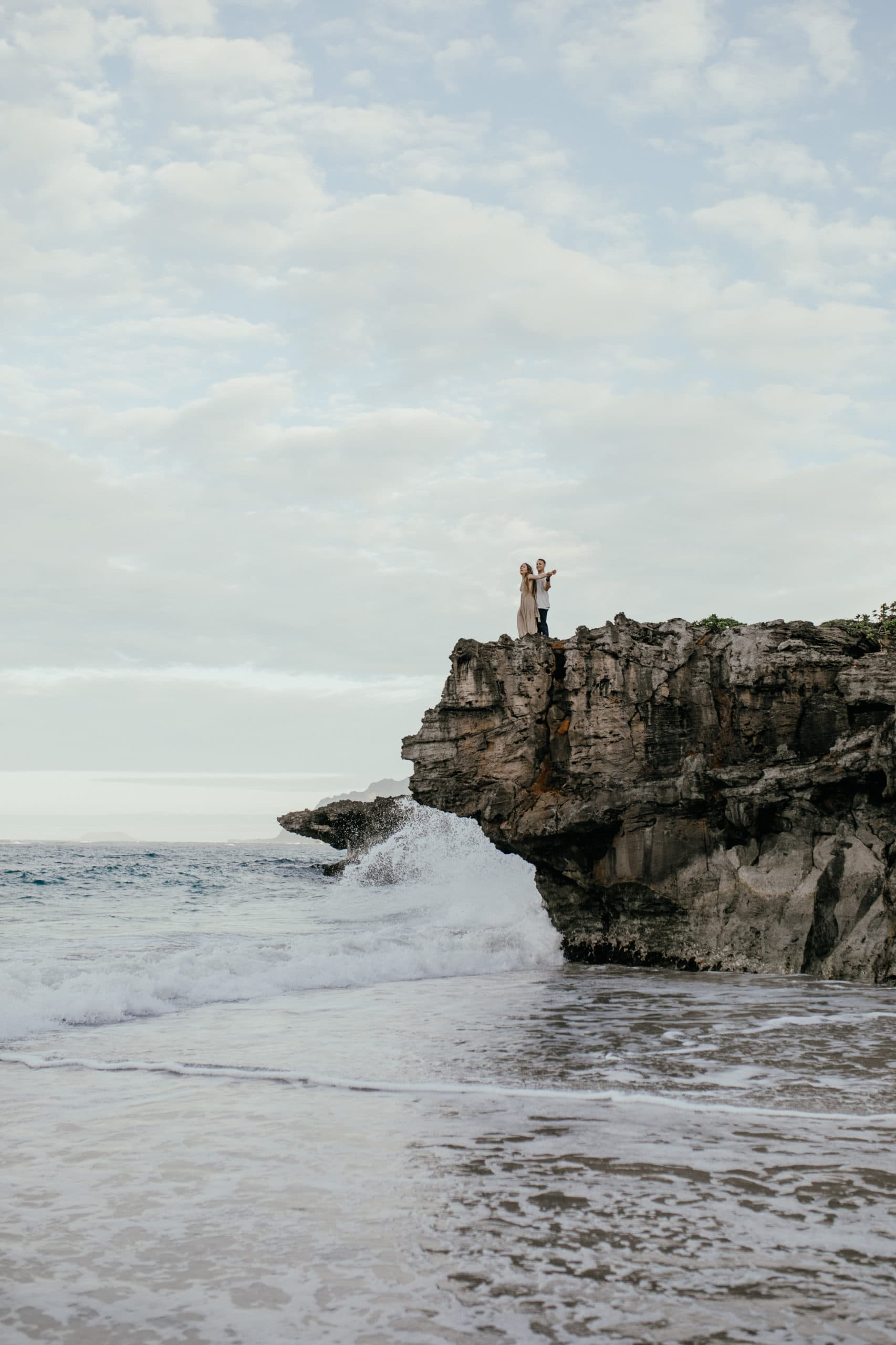 Oahu Couples Photography, far off shot of couple standing on a cliff