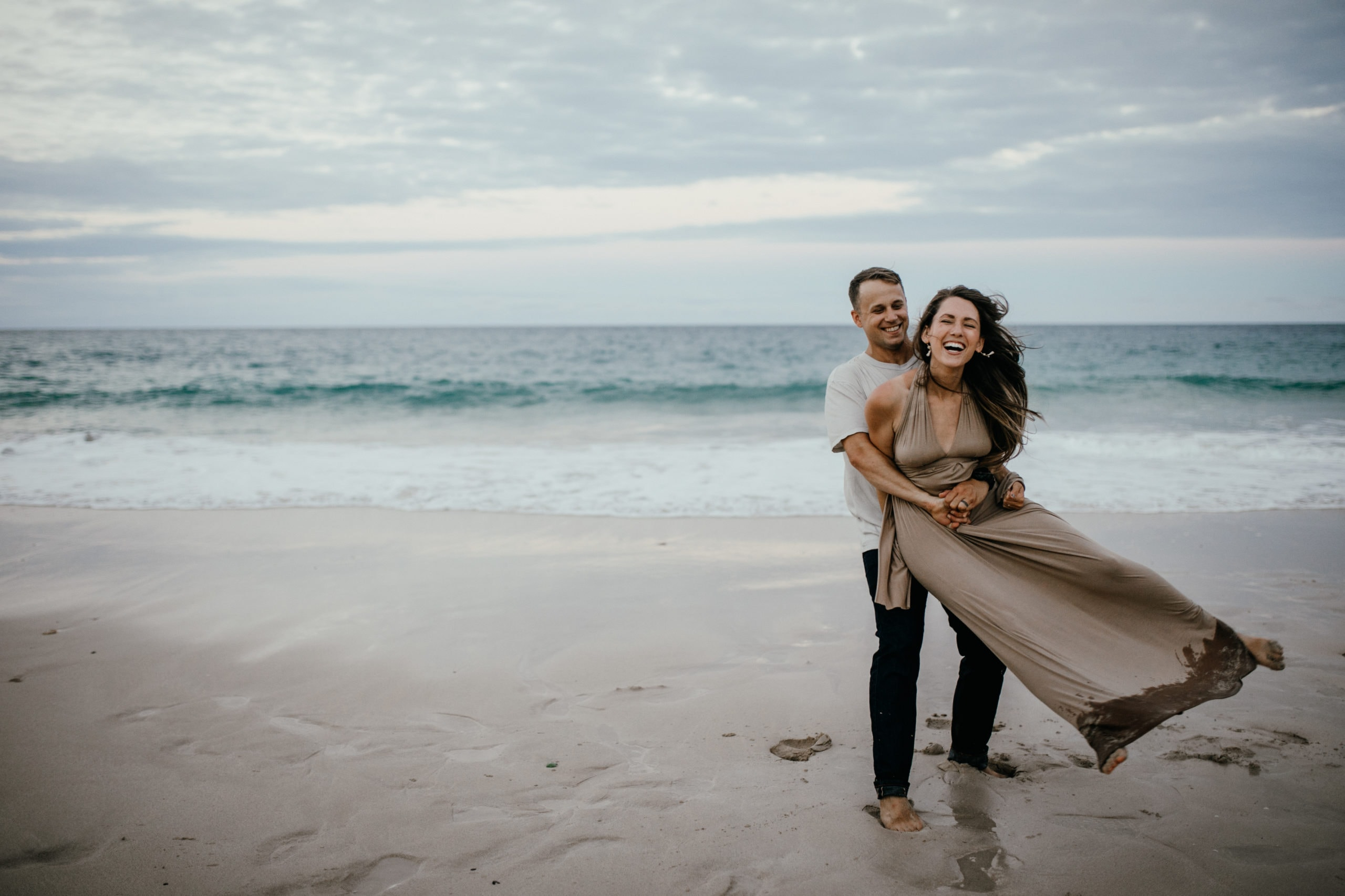 Oahu Couples Photography, couple standing and playing in the sand