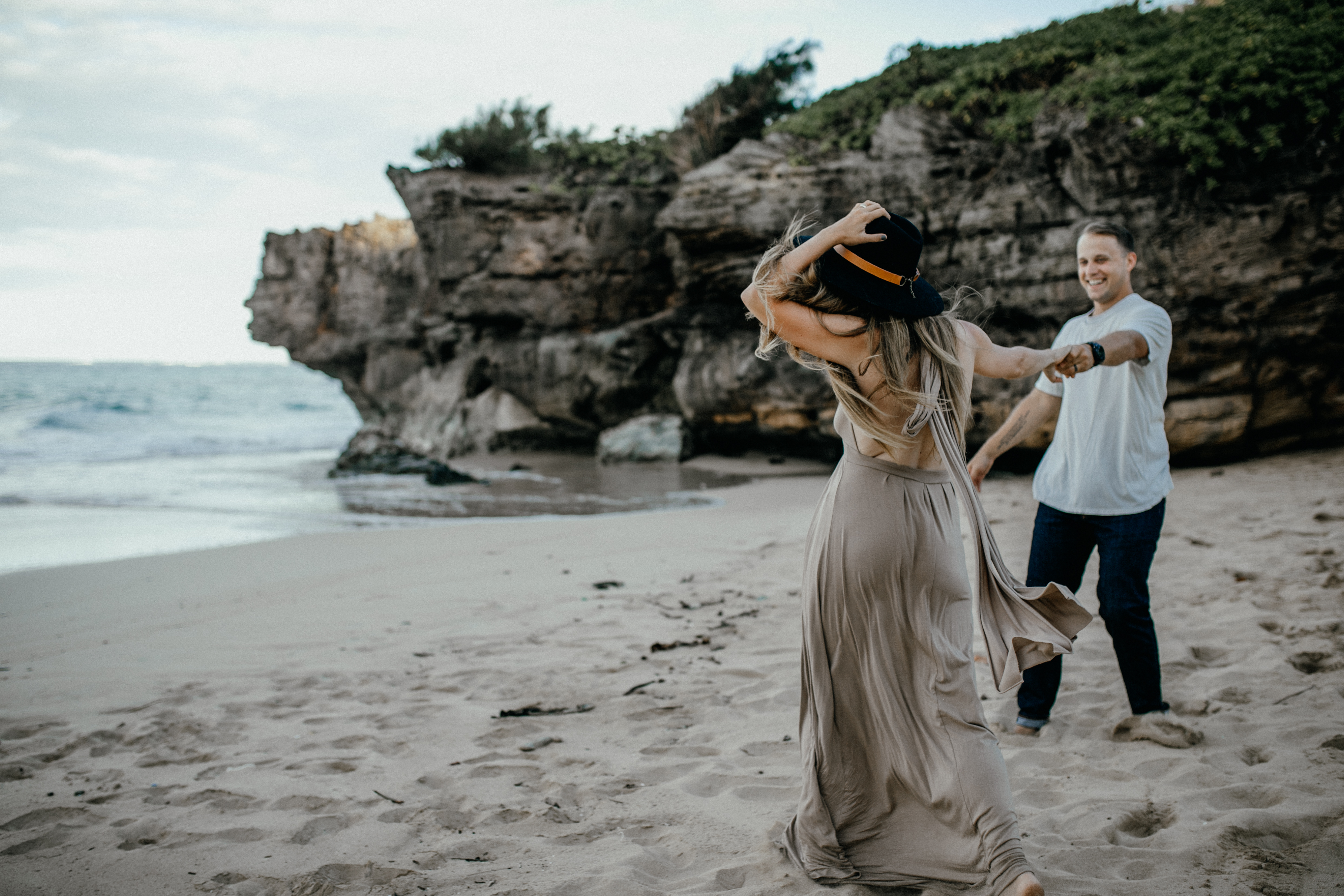 Oahu Couples Photography, couple dancing together on the beach