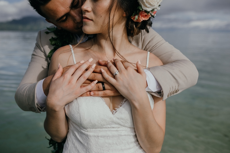 Oahu Wedding Photography, close up of grooms arms wrapped around his bride