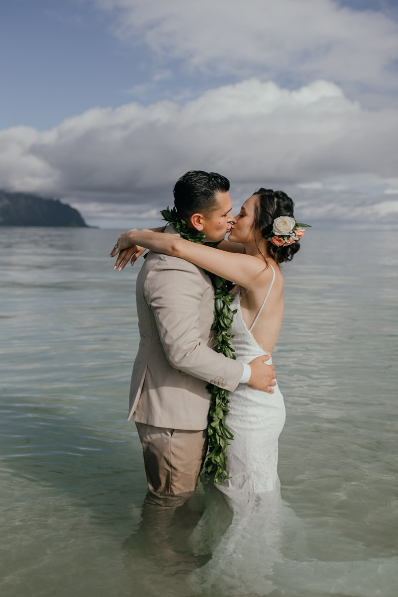 Oahu Wedding Photography, couple kissing in the water