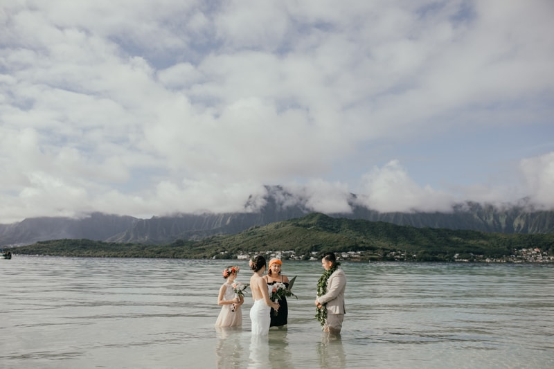 Oahu Wedding Photography, couple getting married while standing in the ocean