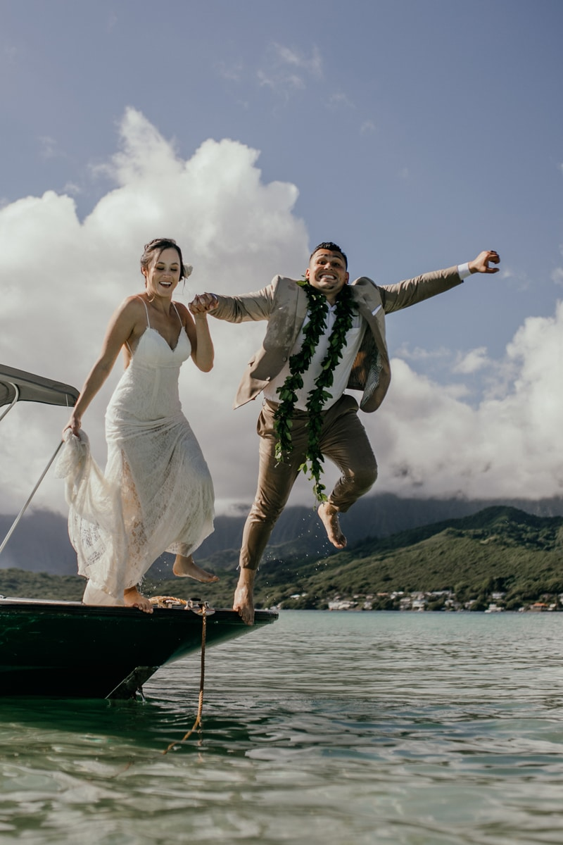 Oahu Wedding Photography, couple jumping from a boat together
