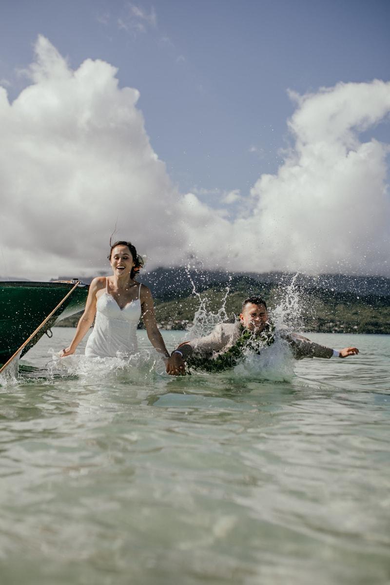 Oahu Wedding Photography, couple splashing into the water