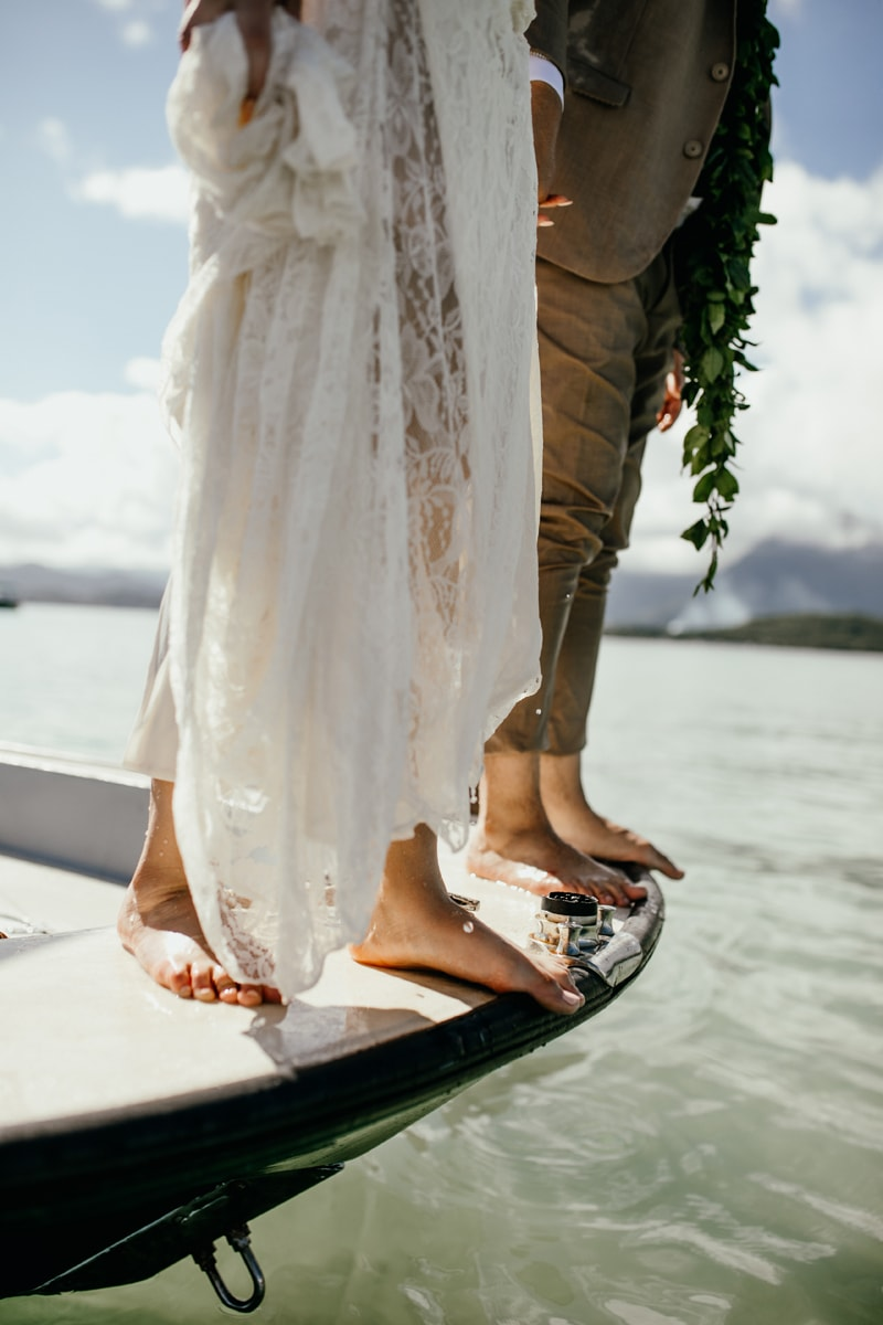 Oahu Wedding Photography, close up of couples feet at the end of a boat