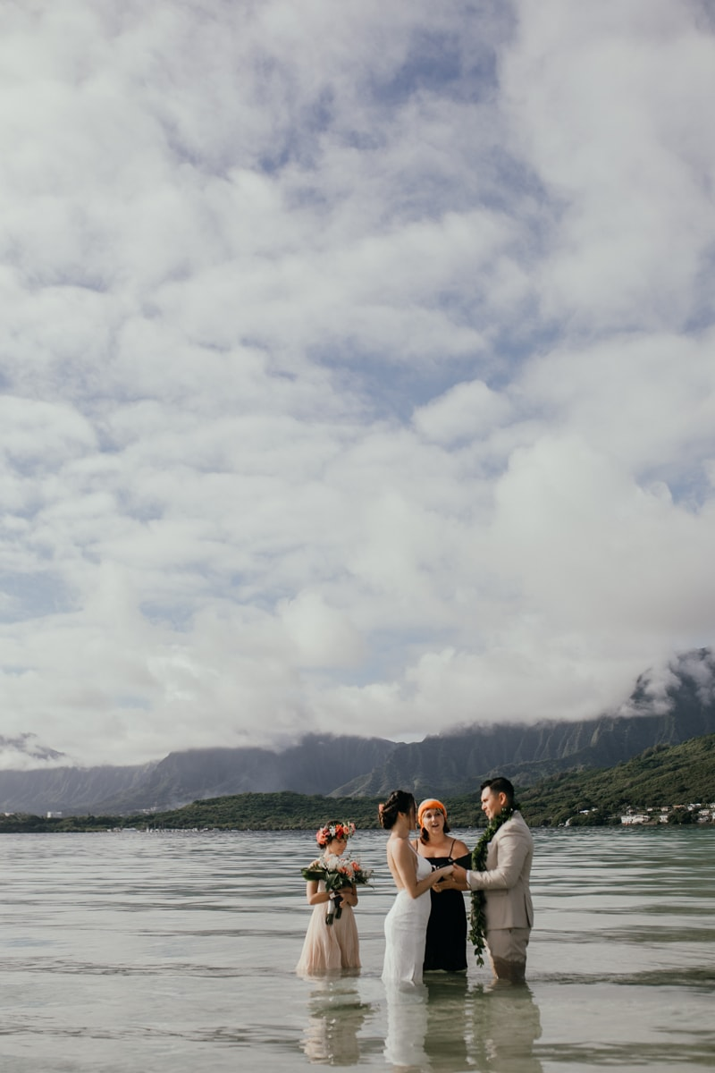 Oahu Wedding Photography, couple standing holding hands in the water during ceremony