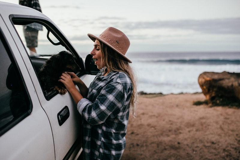 Oahu Couples Photography, woman petting dog through the car window