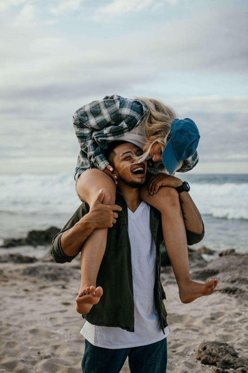 Oahu Couples Photography, woman on man's shoulders laughing together