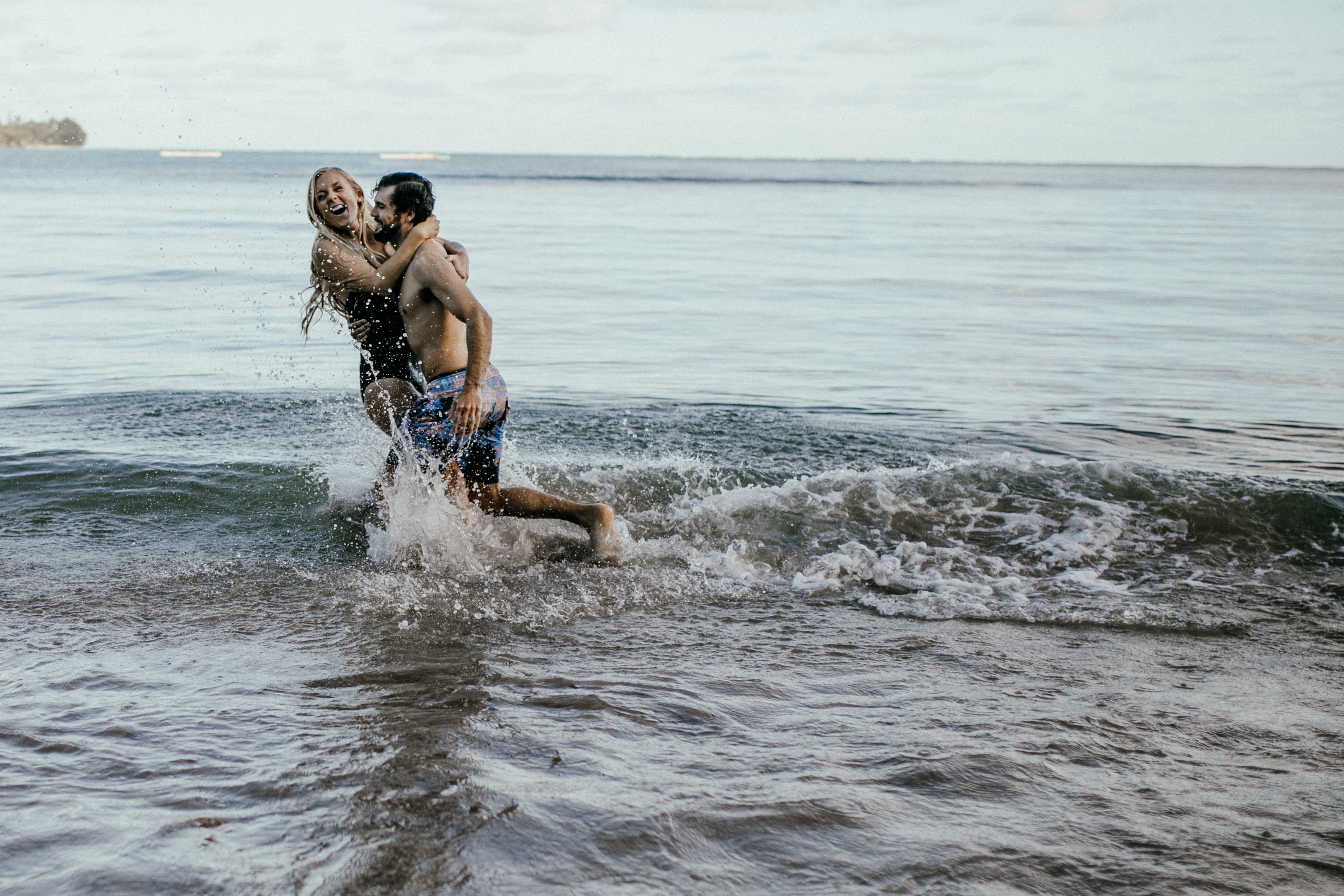 Oahu Couples Photography, couple playing together in the waves