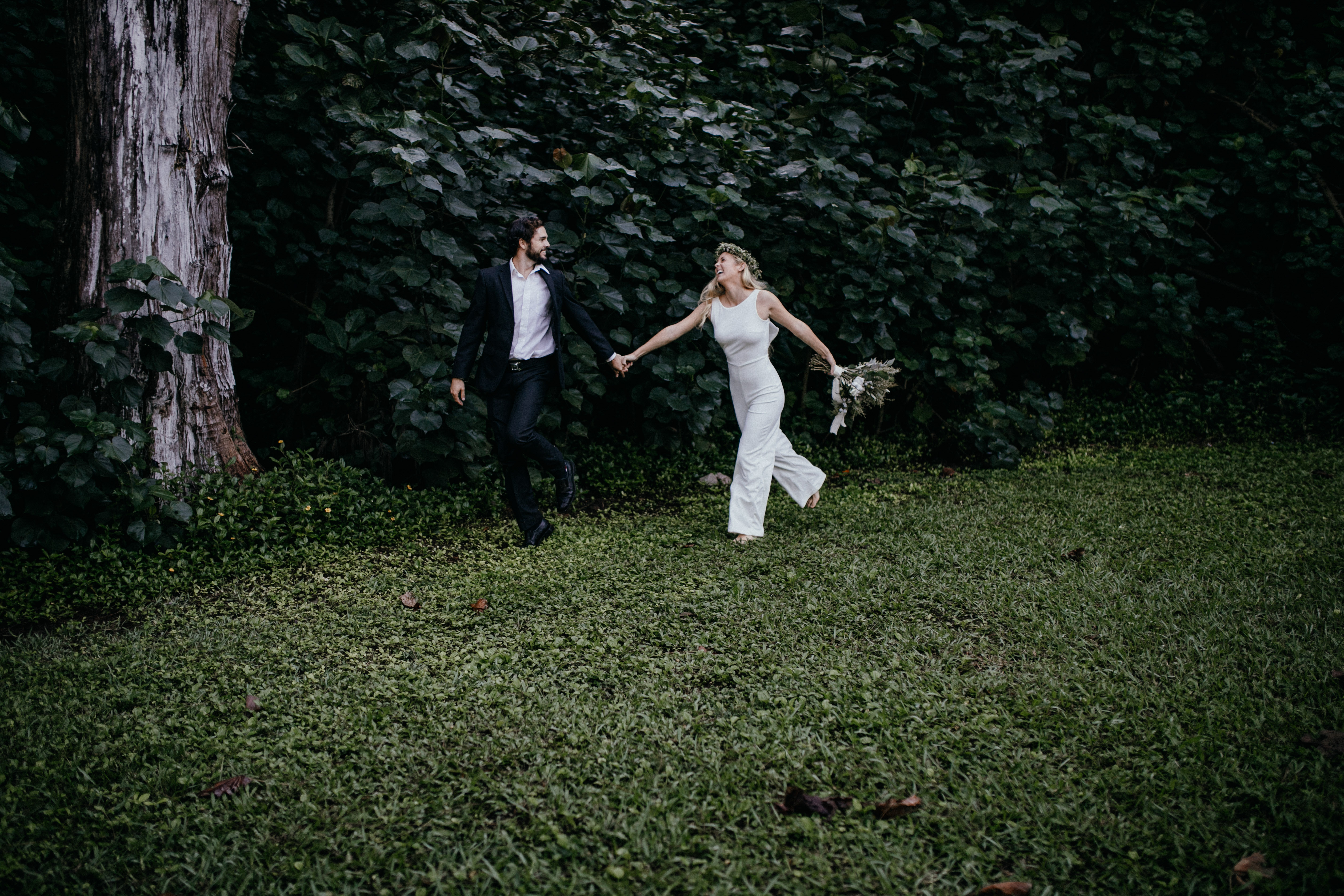 Oahu Wedding Photography, couple walking in the grass