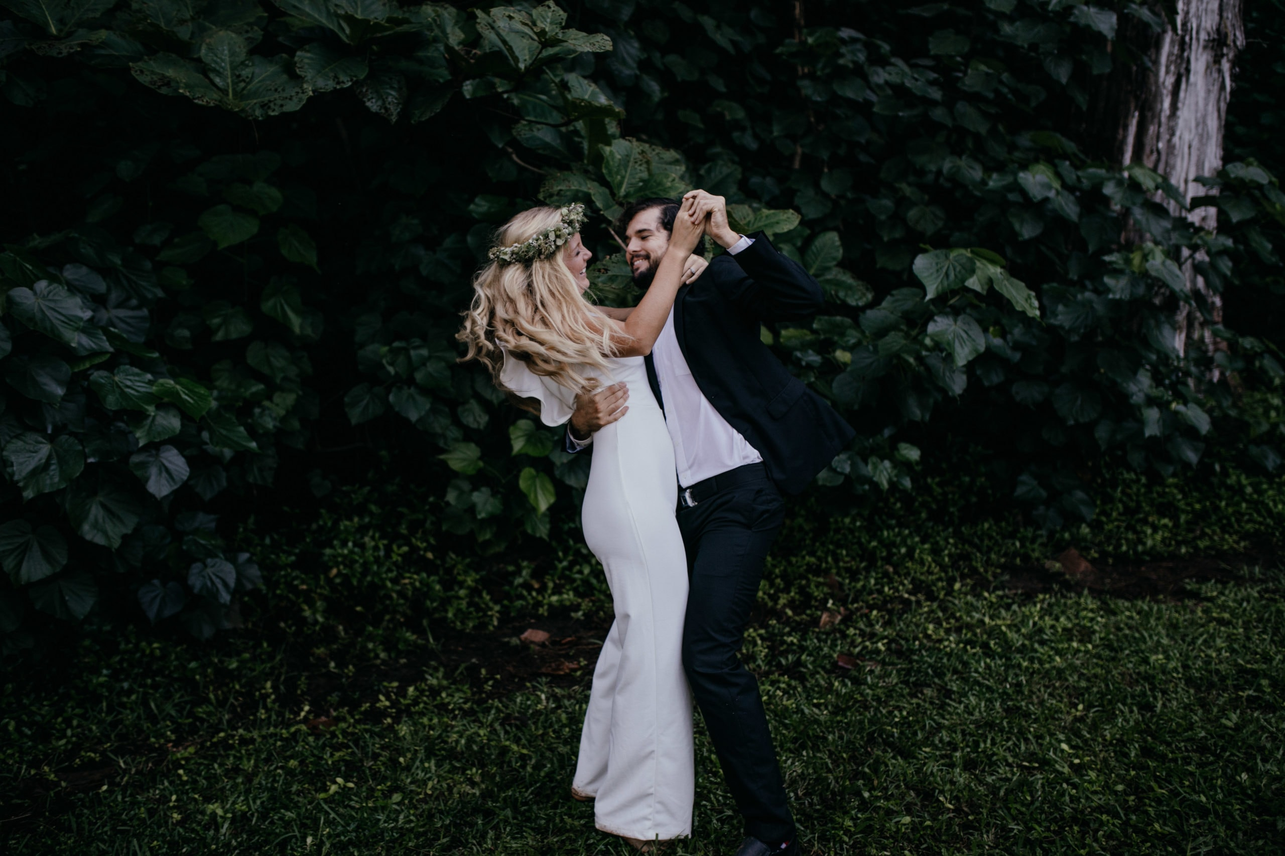Oahu Wedding Photography, bride and groom dancing in the grass