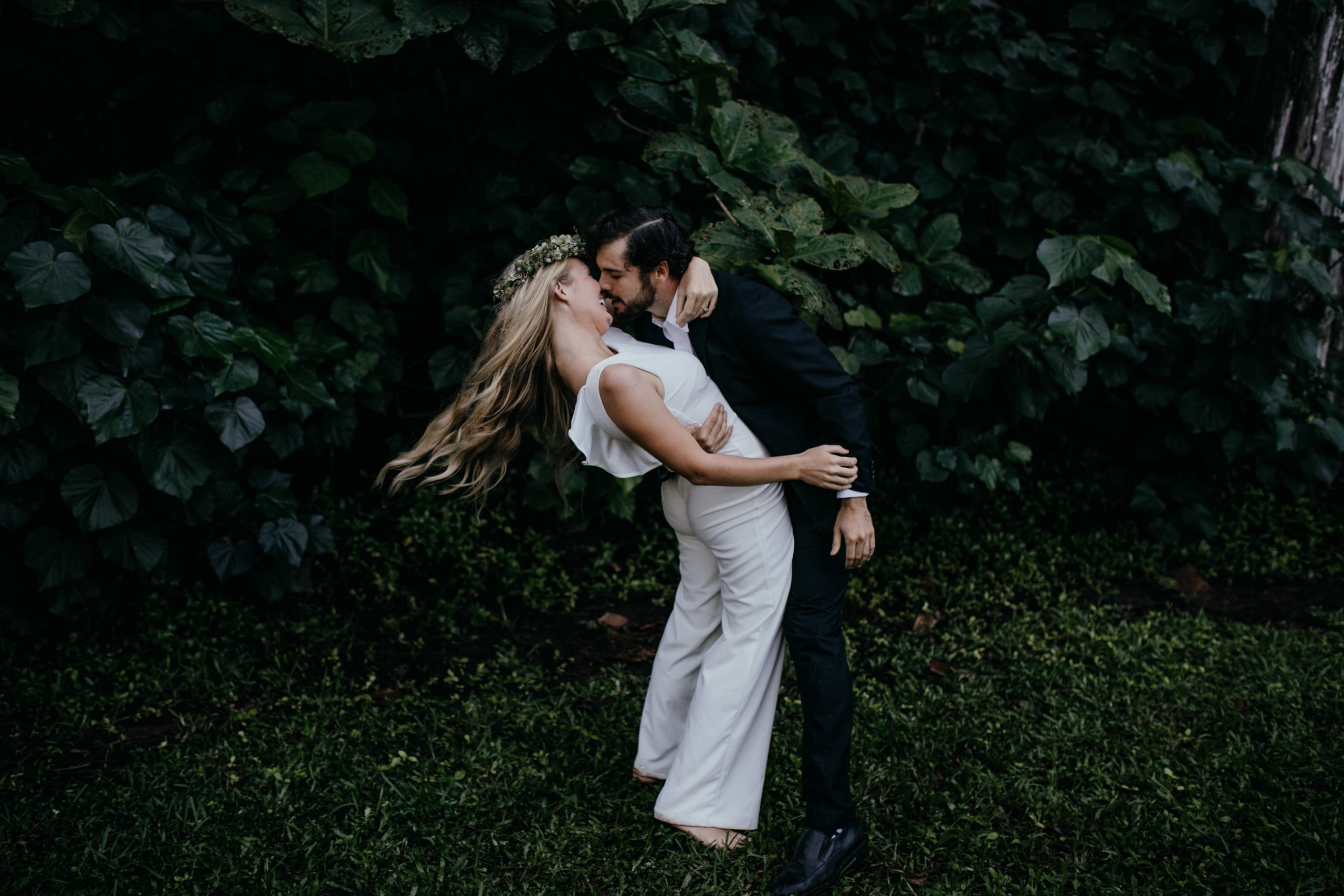 Oahu Wedding Photography, groom leaning bride back and giving her a kiss