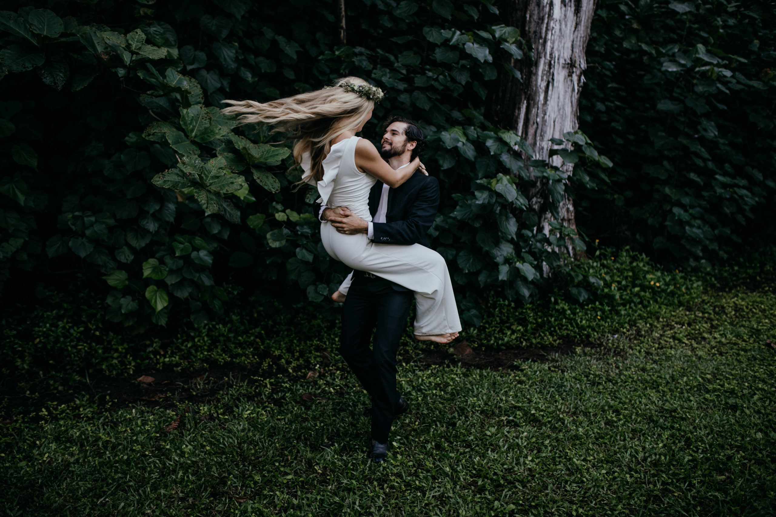 Oahu Wedding Photography, couple twirling in the grass