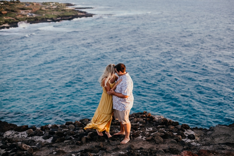 Oahu Couples Photography, couple standing barefoot on a cliff shoreline