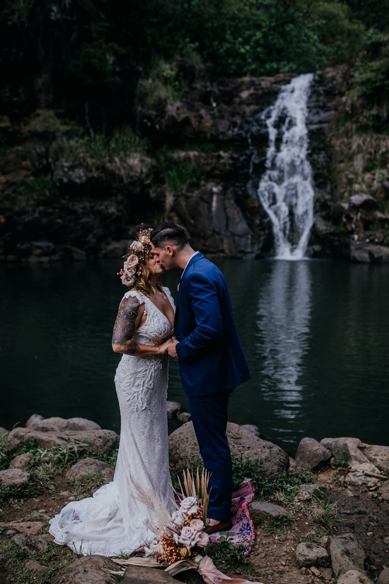 Oahu Wedding Photography, couple kissing next to a waterfall