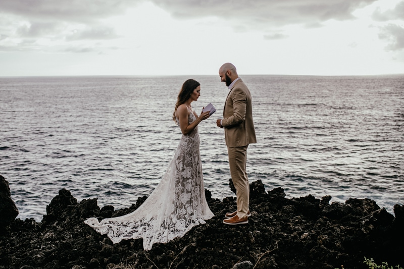 Oahu Wedding Photography, couple getting married on rocks next to the beach