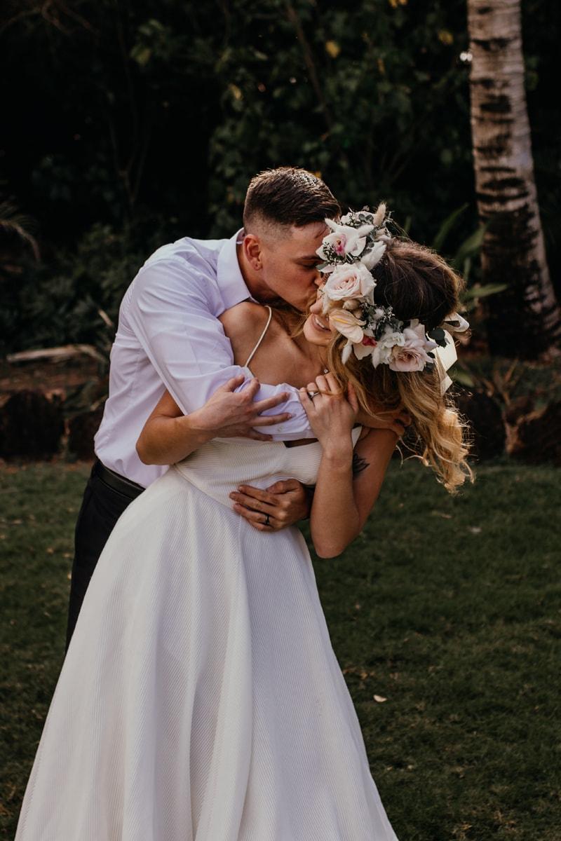 Oahu Wedding Photography, groom kissing bride on her cheek