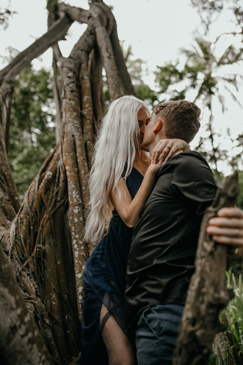 Oahu Couples Photography, couple kissing while standing up in a tree