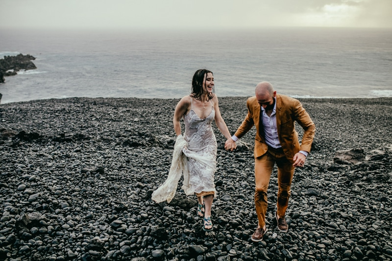 Oahu Wedding Photography, bride and groom running in the rain