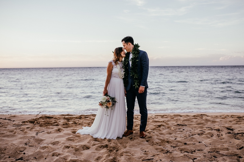 Oahu Wedding Photography, bride and groom kissing on the beach