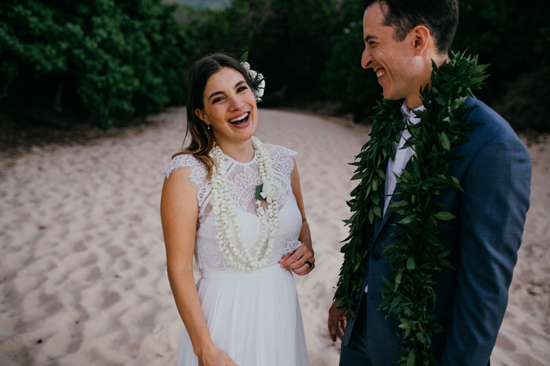 Oahu Wedding Photography, bride and groom laughing on the beach together
