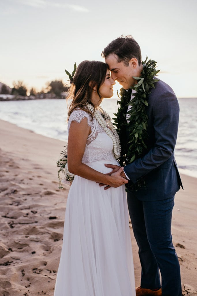 Oahu Wedding Photography & Elopement Photography, couple resting their foreheads together and holding hands next to the ocean