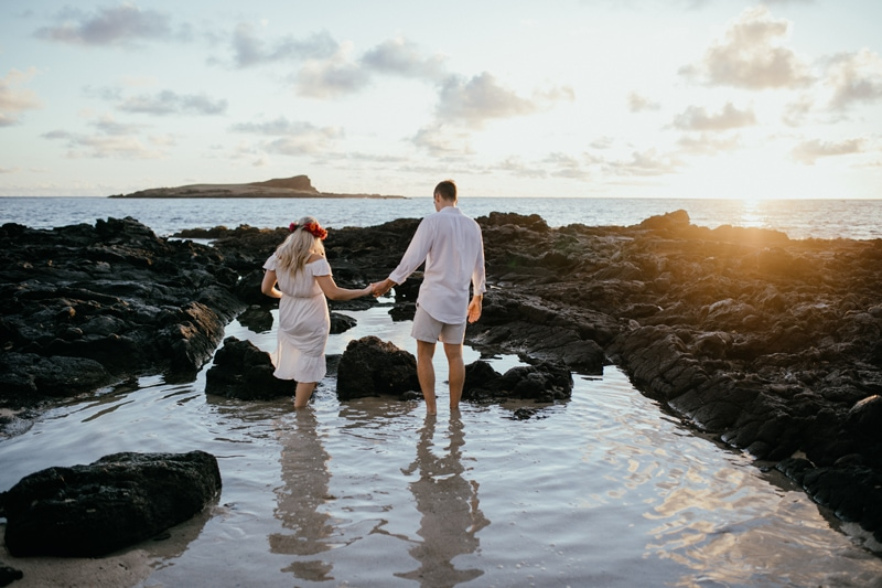 Oahu Couples Photography, couple wearing white wading through a tide pool