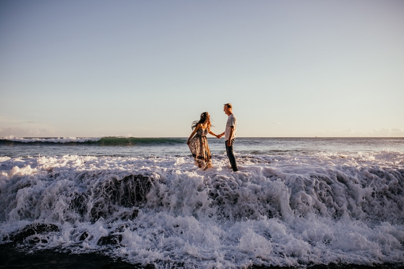 Oahu Couples Photography, wide angle shot of couple standing in the waves