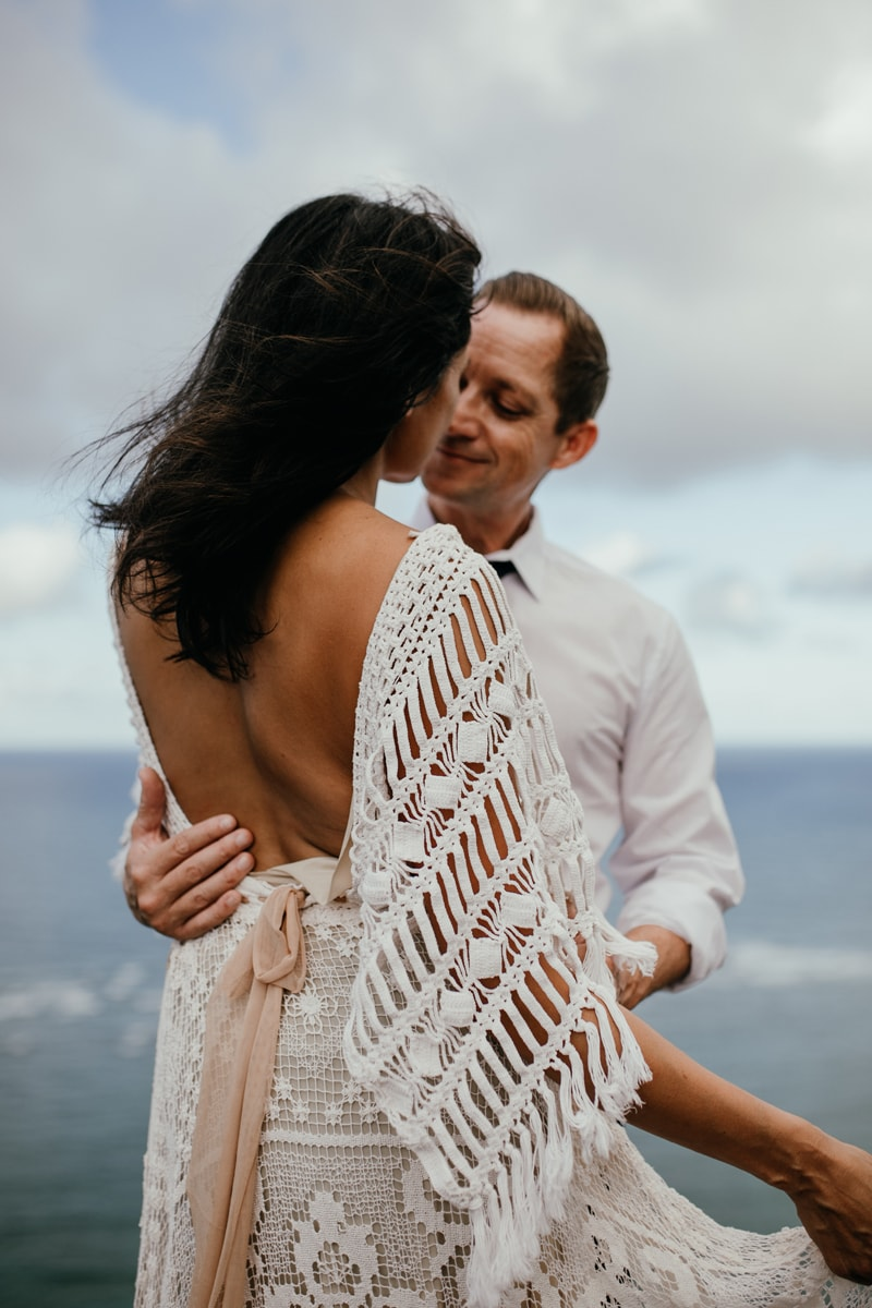Oahu Wedding Photography, groom looking at his bride