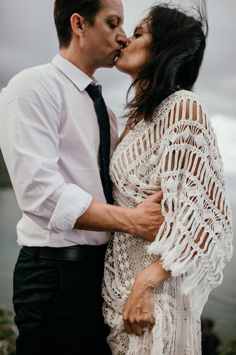 Oahu Wedding Photography, close up of bride and grooms bodies as they are about to kiss