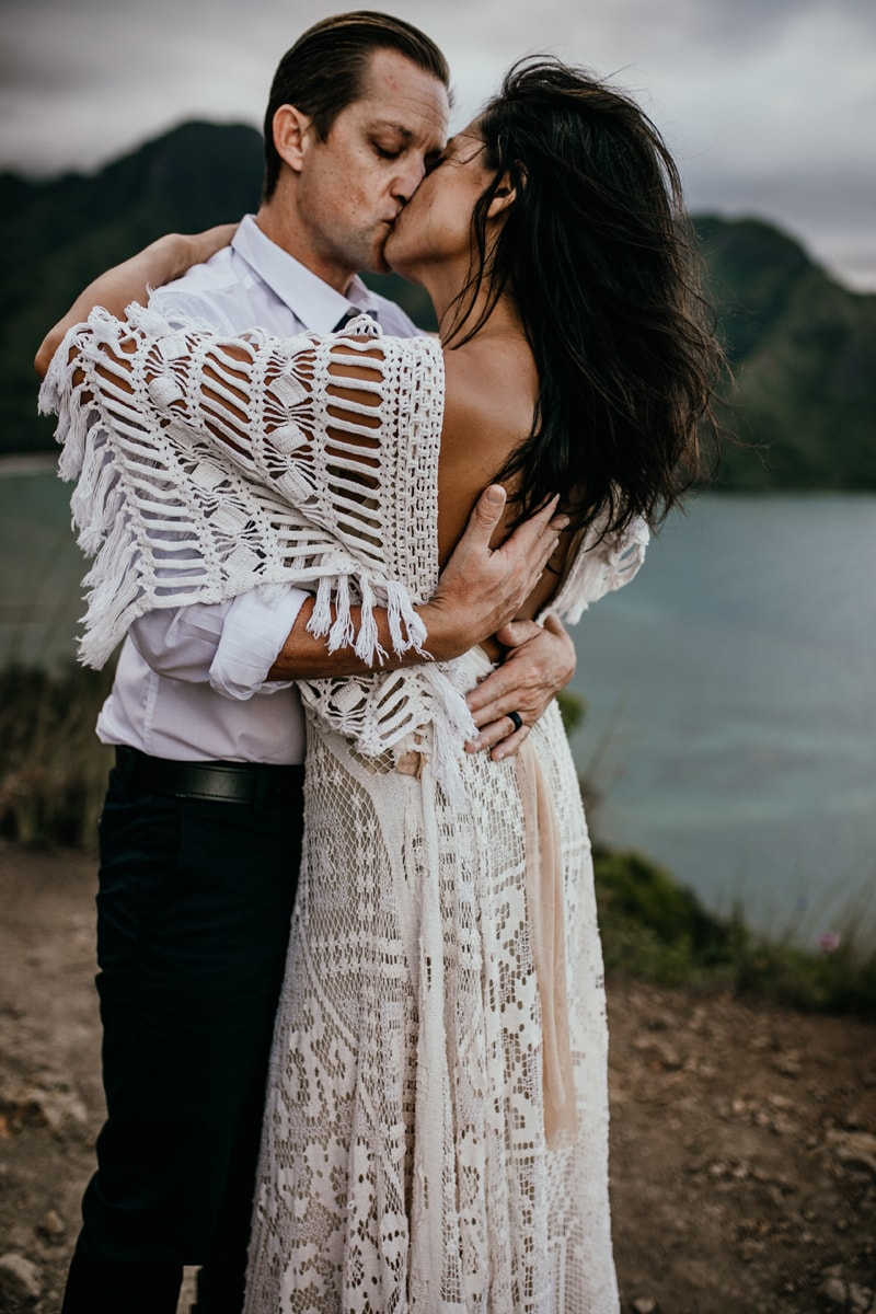Oahu Wedding Photography, bride with her arms around her groom