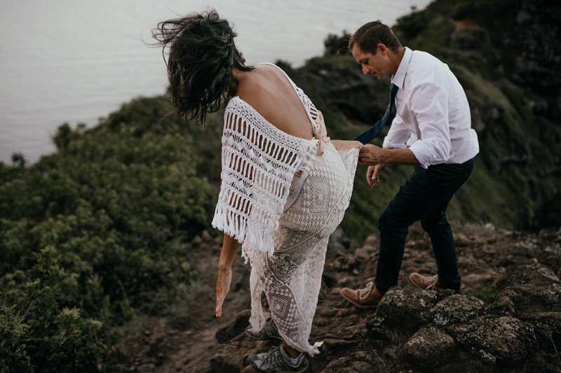 Oahu Wedding Photography, groom leading his bride down a dirt path to the beach