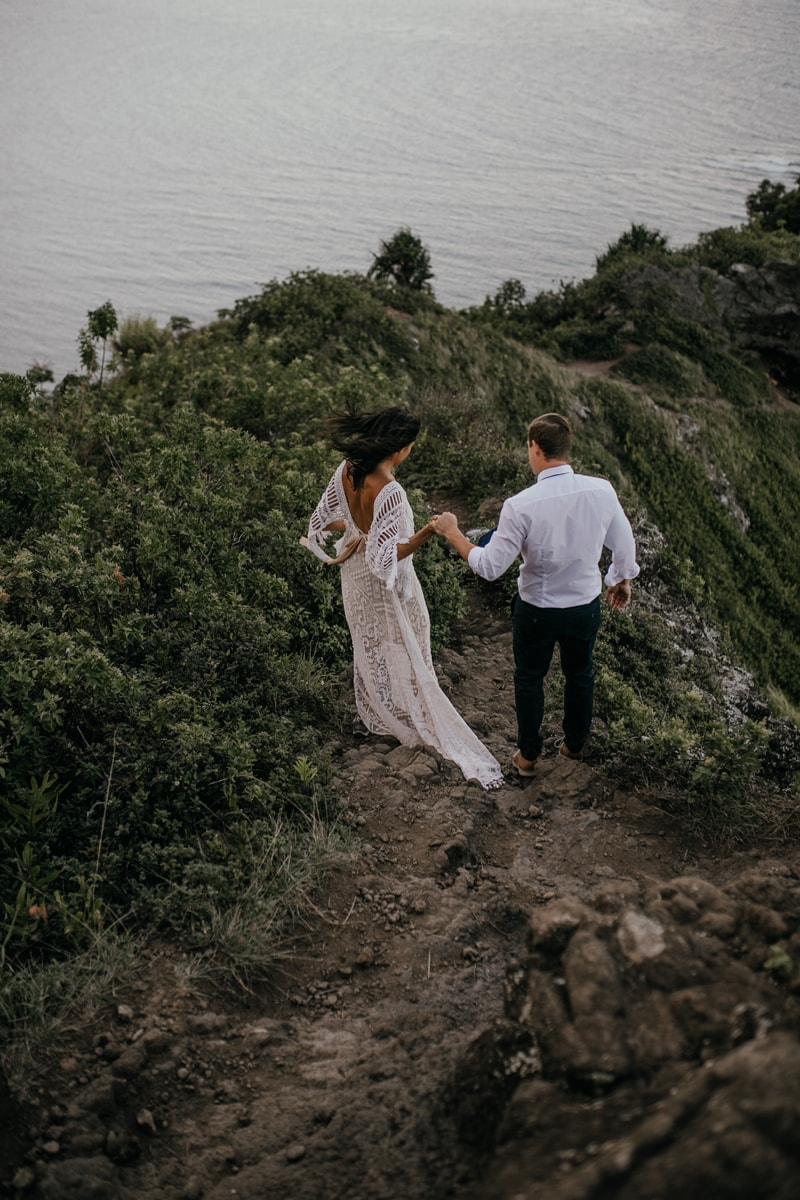 Oahu Wedding Photography, walking down a dirt path hand in hand