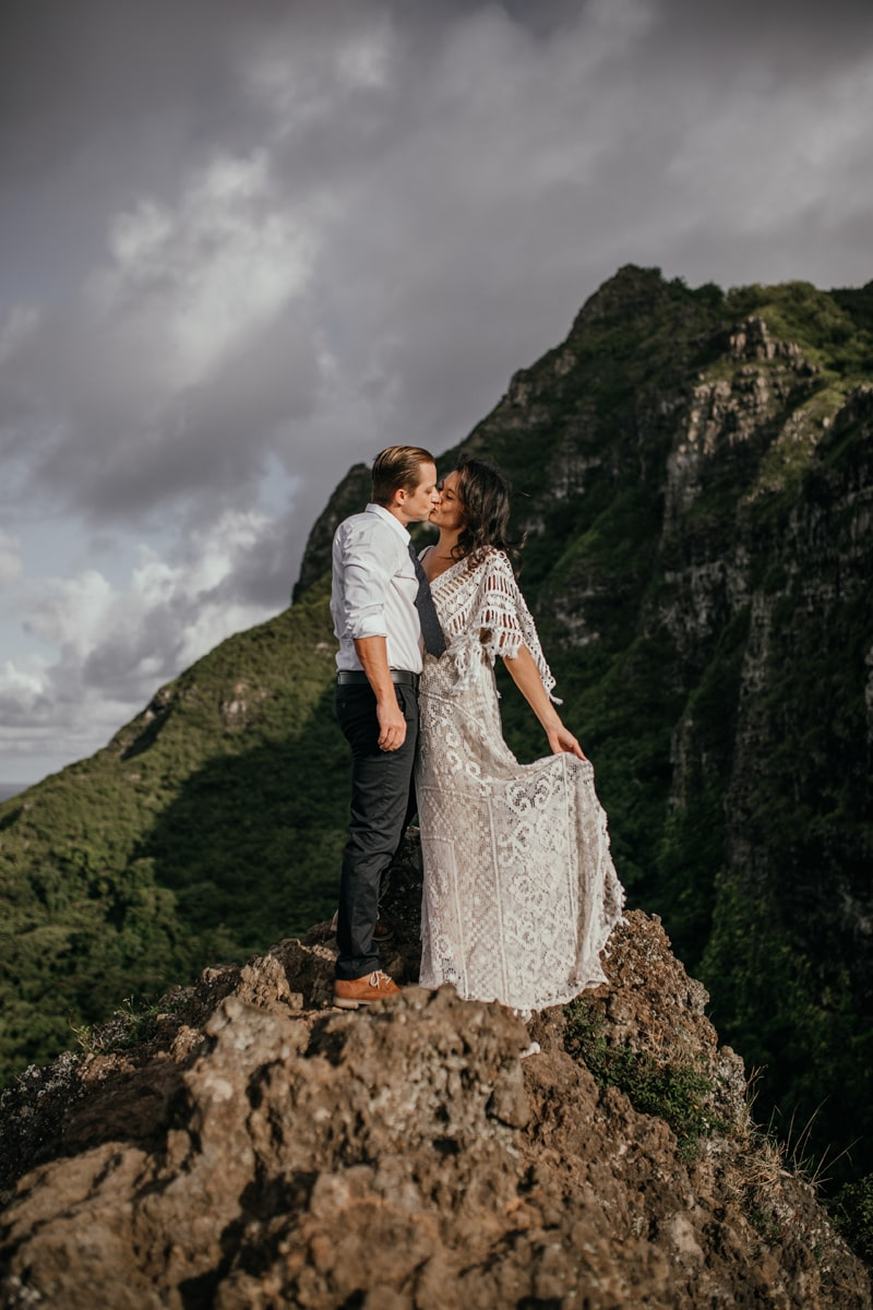 Oahu Wedding Photography, couple kissing while standing on rocks together