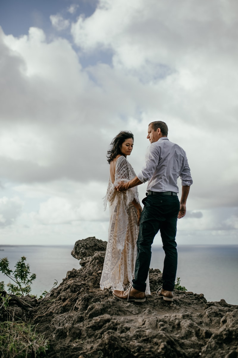 Oahu Wedding Photography, bride and groom standing at the point of a cliff