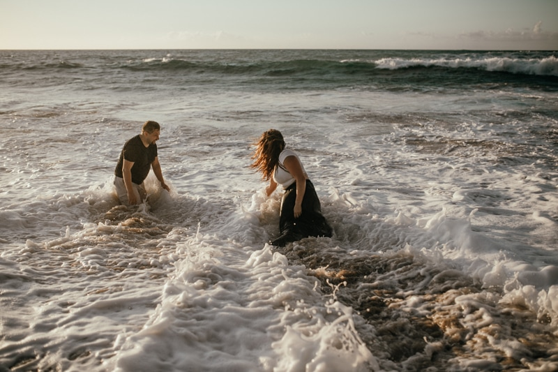 Oahu Couples Photography, couple splashing and playing in the water together