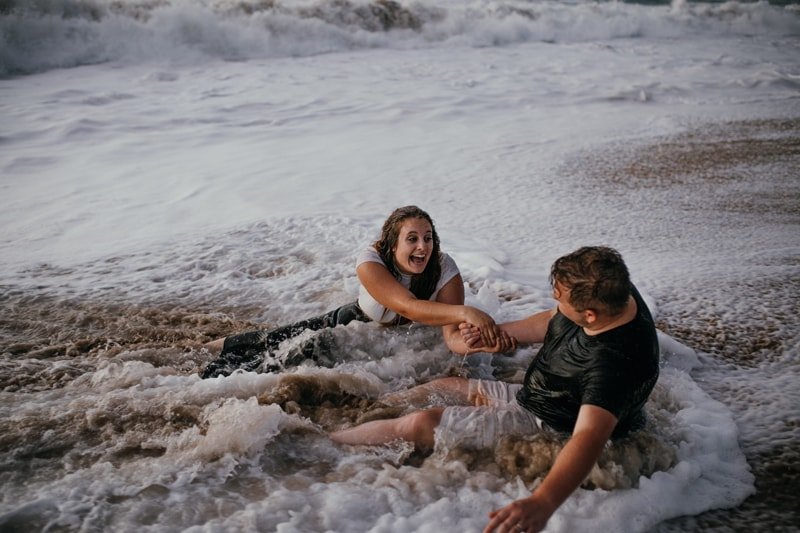 Oahu Couples Photography, couple sitting and playing in the ocean