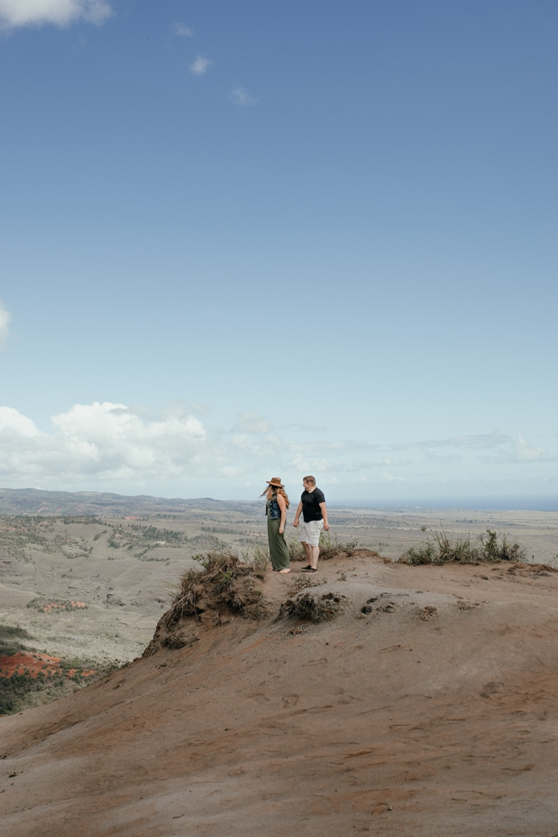 Oahu Couples Photography, wide angle of couple walking on a hillside