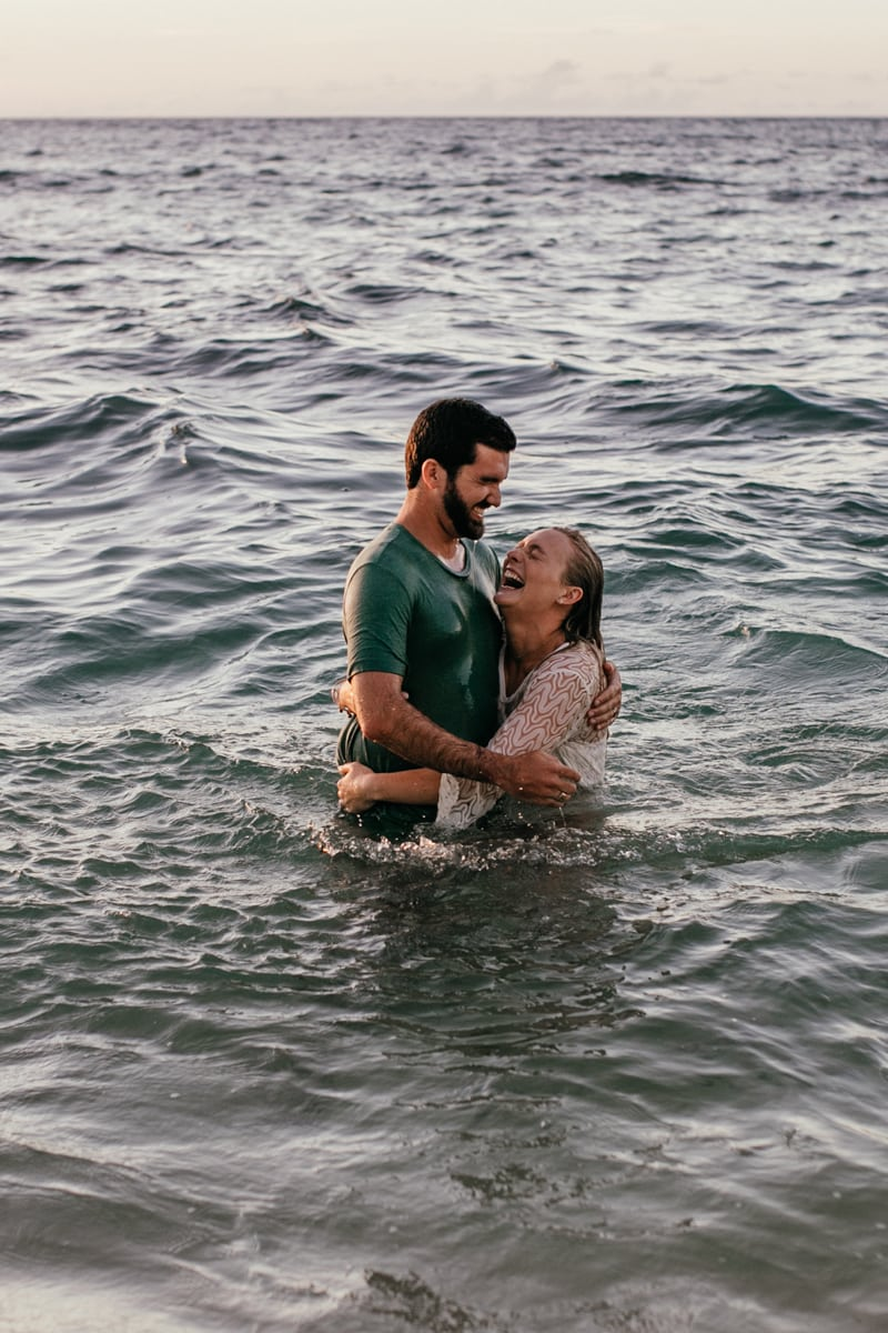 Oahu Couples Photography, couple laughing together in the water