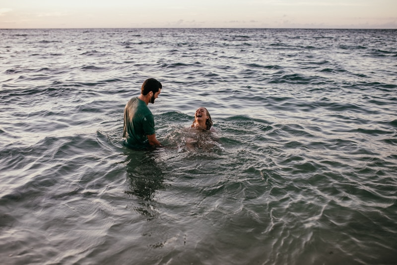 Oahu Couples Photography, couple swimming and laughing together