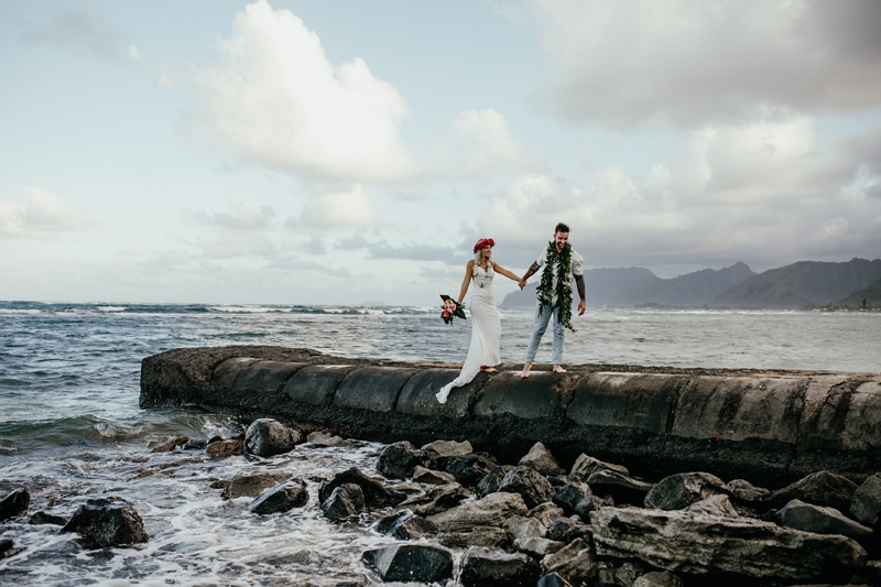 Oahu Wedding Photography, bride and groom walking next to the ocean