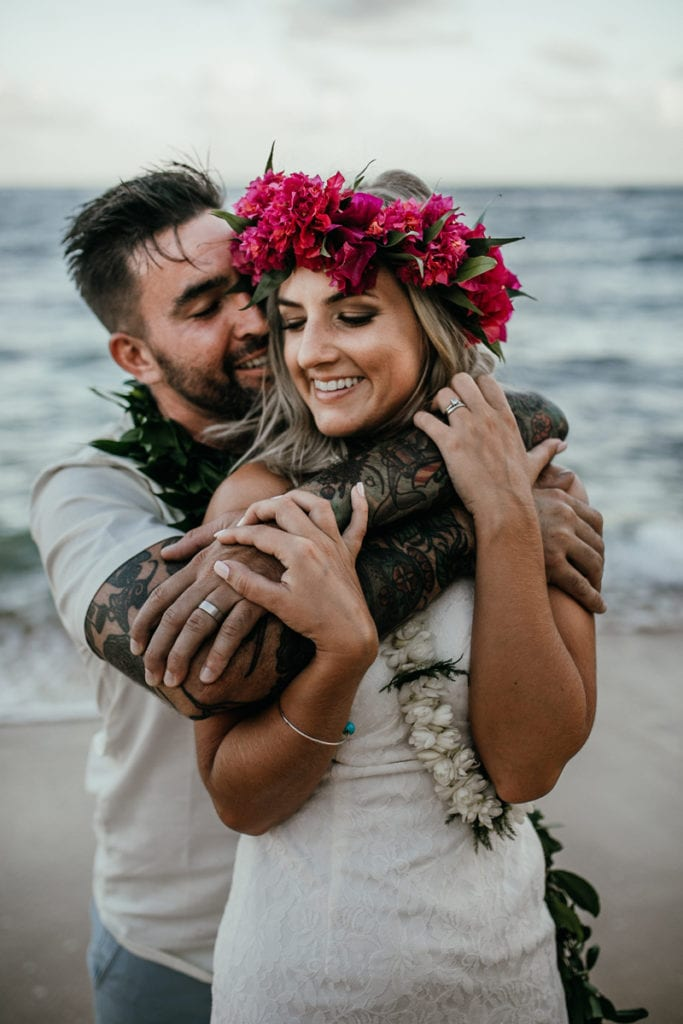Oahu Wedding Photography & Elopement Photography, man with his arms around woman at the beach