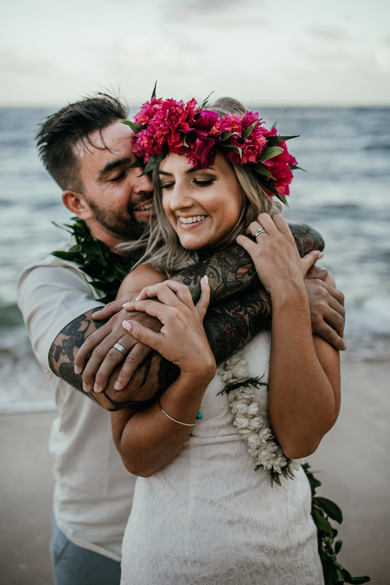 Oahu Wedding Photography, couple standing on the beach with arms around each other