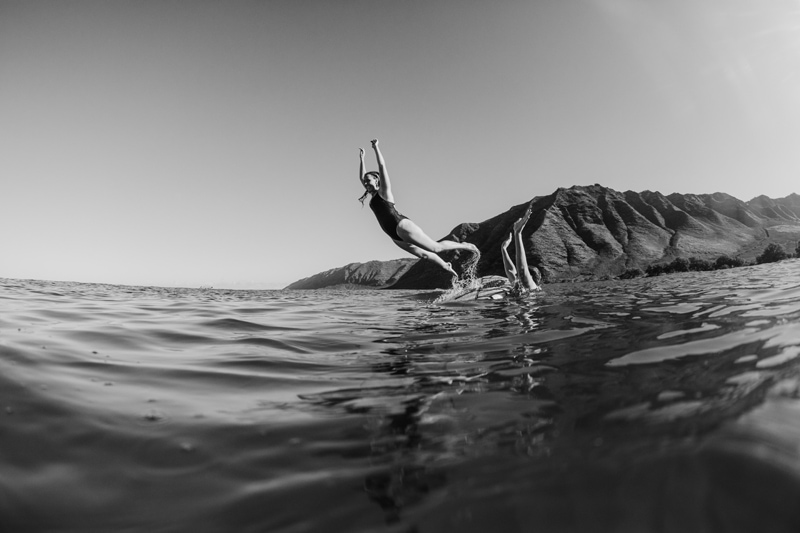 Oahu Couples Photography, black and white of man throwing woman in ocean