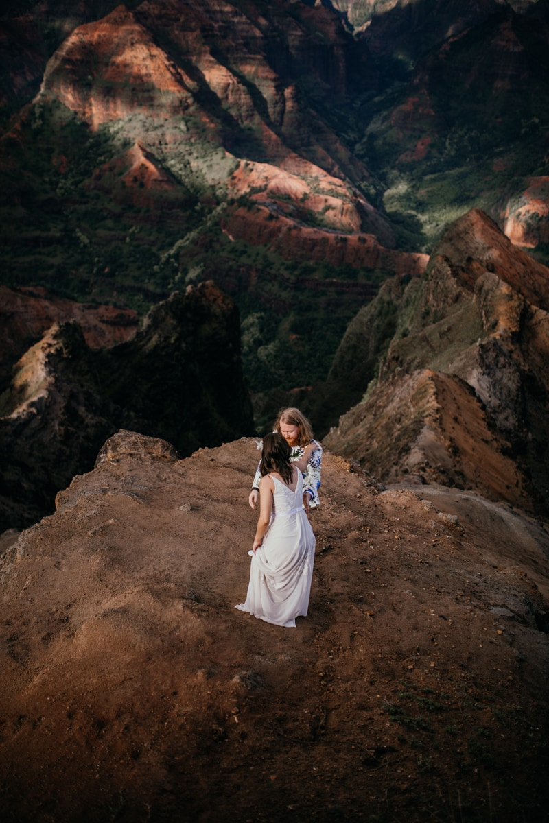 Oahu Wedding Photography, wide angle shot of couple standing on a cliff