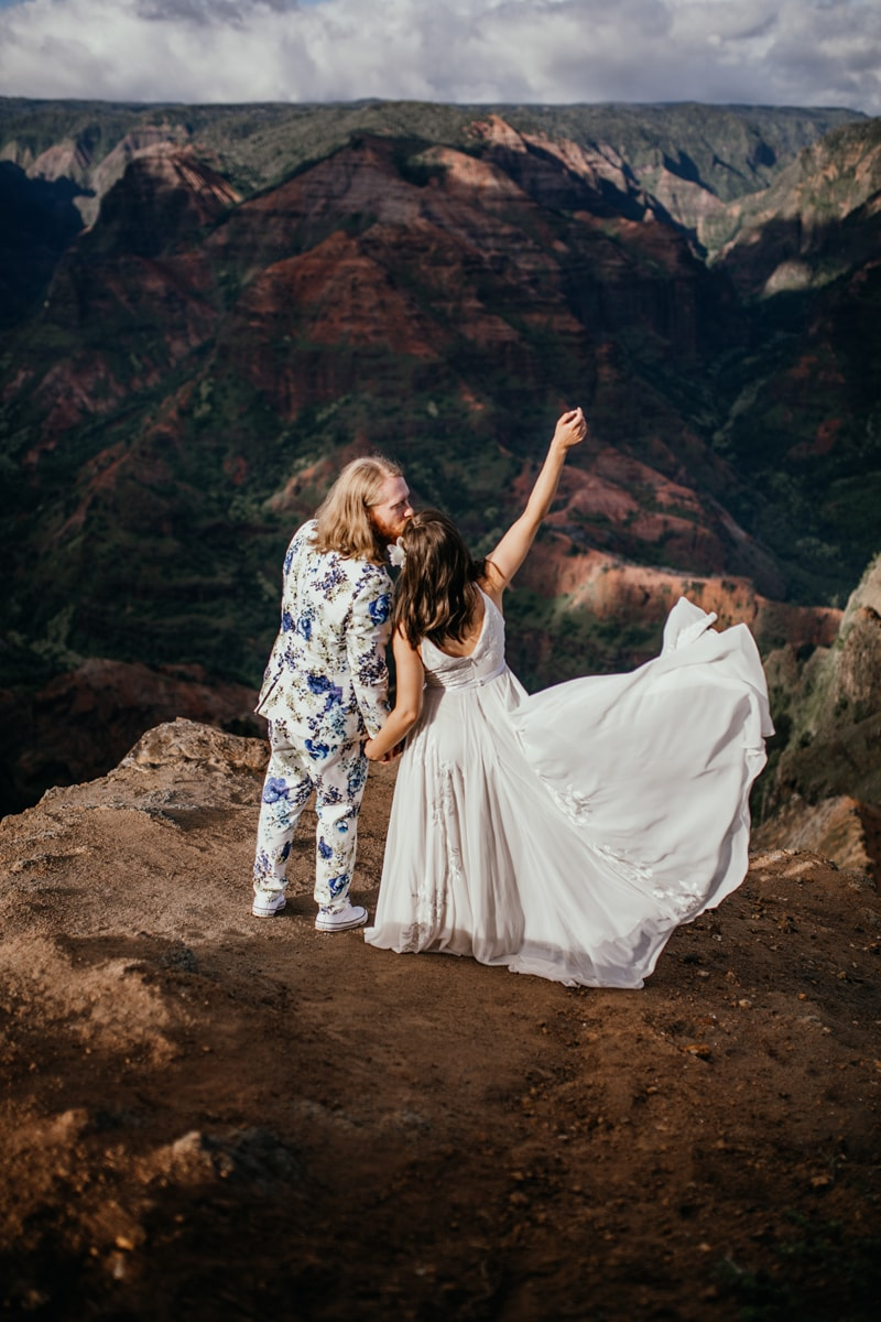 Oahu Wedding Photography, couple kissing on a cliff side