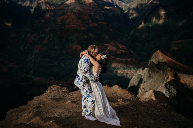 Oahu Wedding Photography, couple kissing on a high cliff