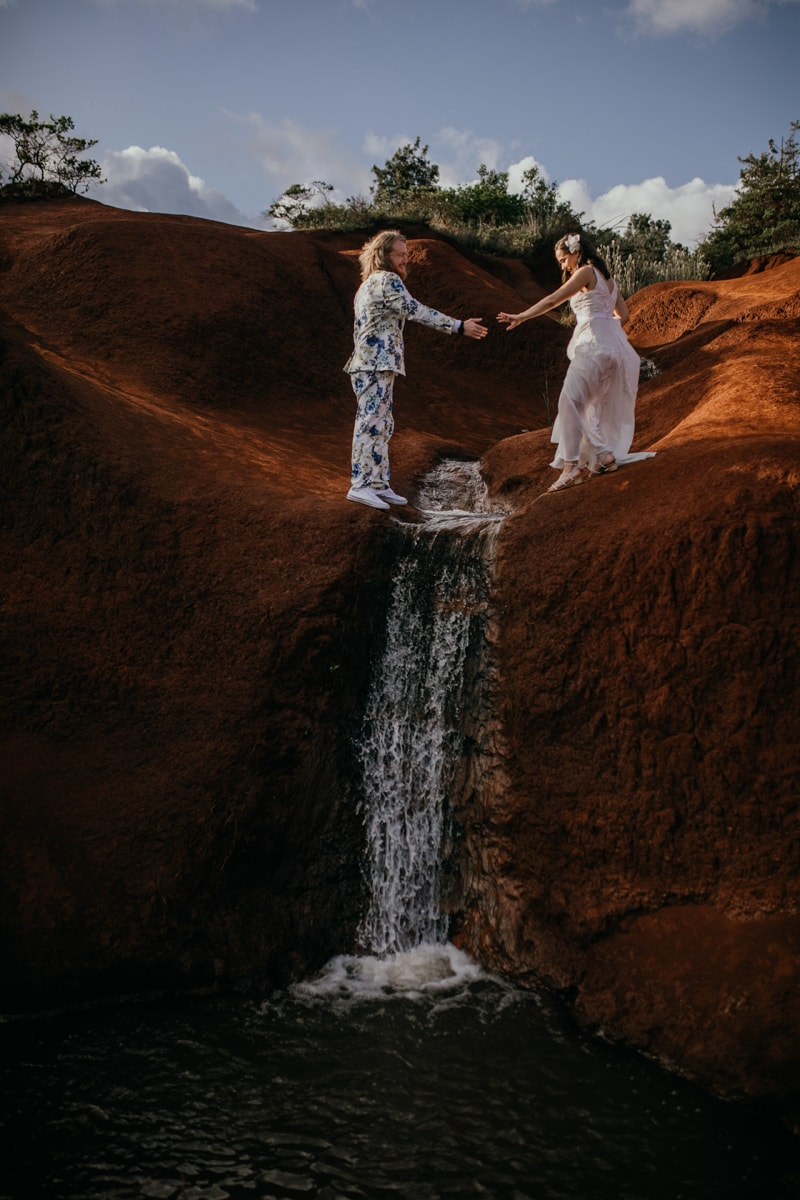 Oahu Wedding Photography, couple standing above a water fall