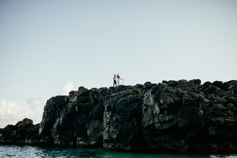 Oahu Wedding Photography, wide angle shot of couple on a cliff