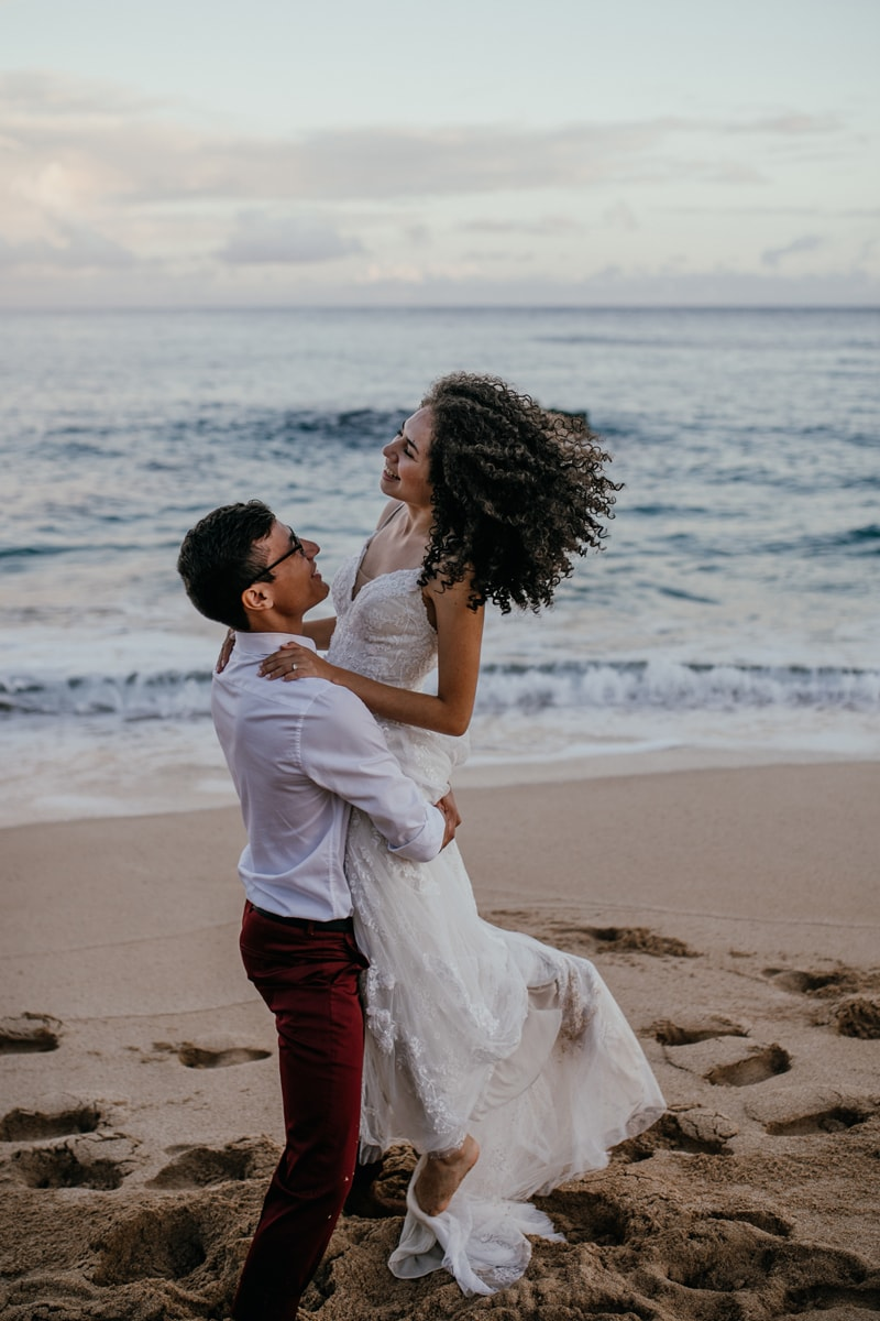 Oahu Wedding Photography, groom lifting bride into the air
